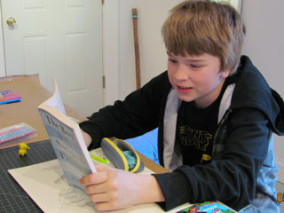 boy in hoodie reading